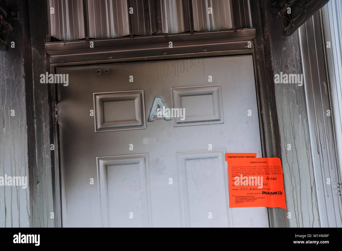 Miami Beach Florida Washington Avenue unsafe building notice residence condominium fire damaged - Stock Image