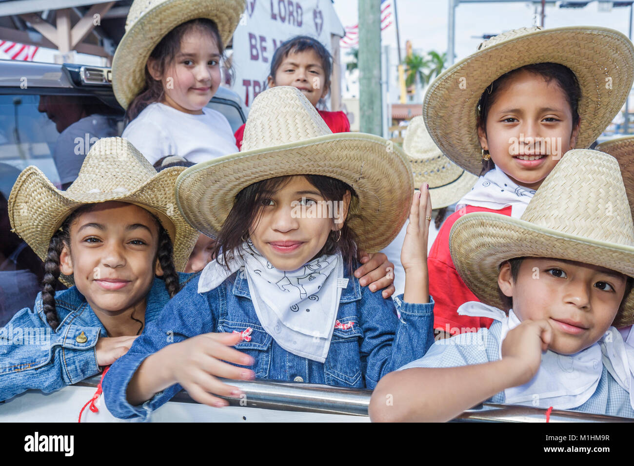tradition Hispanic girls boy children Mexican hats bandanas Western attire outfit - Stock Image