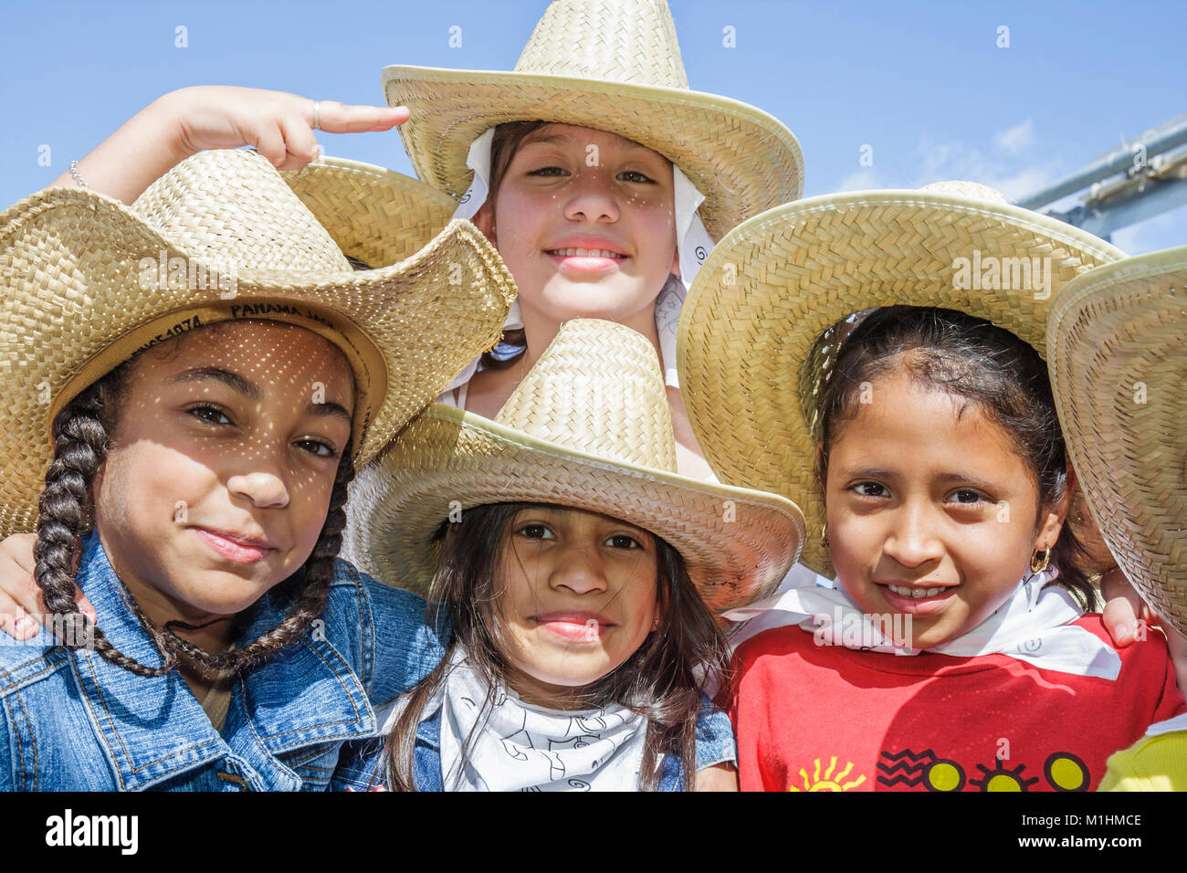 tradition Hispanic girls Mexican hats bandanas Western attire outfit - Stock Image