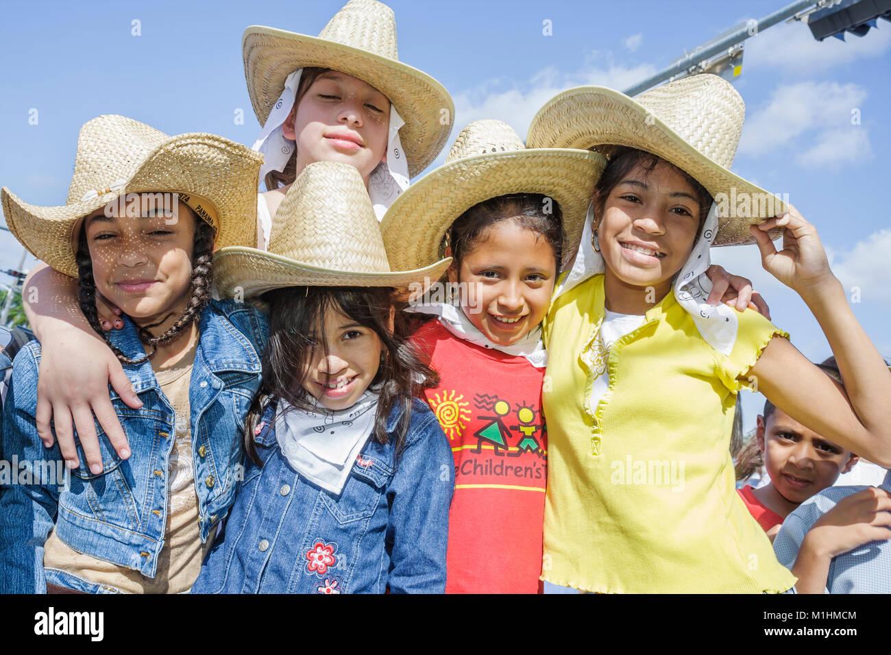 tradition Hispanic girls boy Mexican hats bandanas Western attire outfit - Stock Image