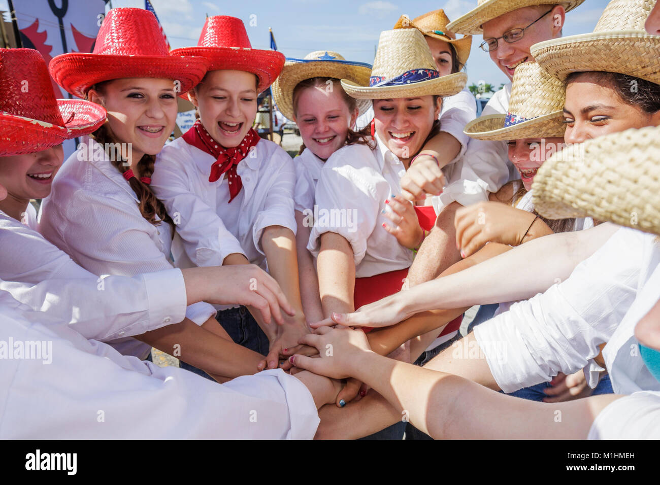 tradition girl teen camaraderie teamwork Western attire outfit - Stock Image