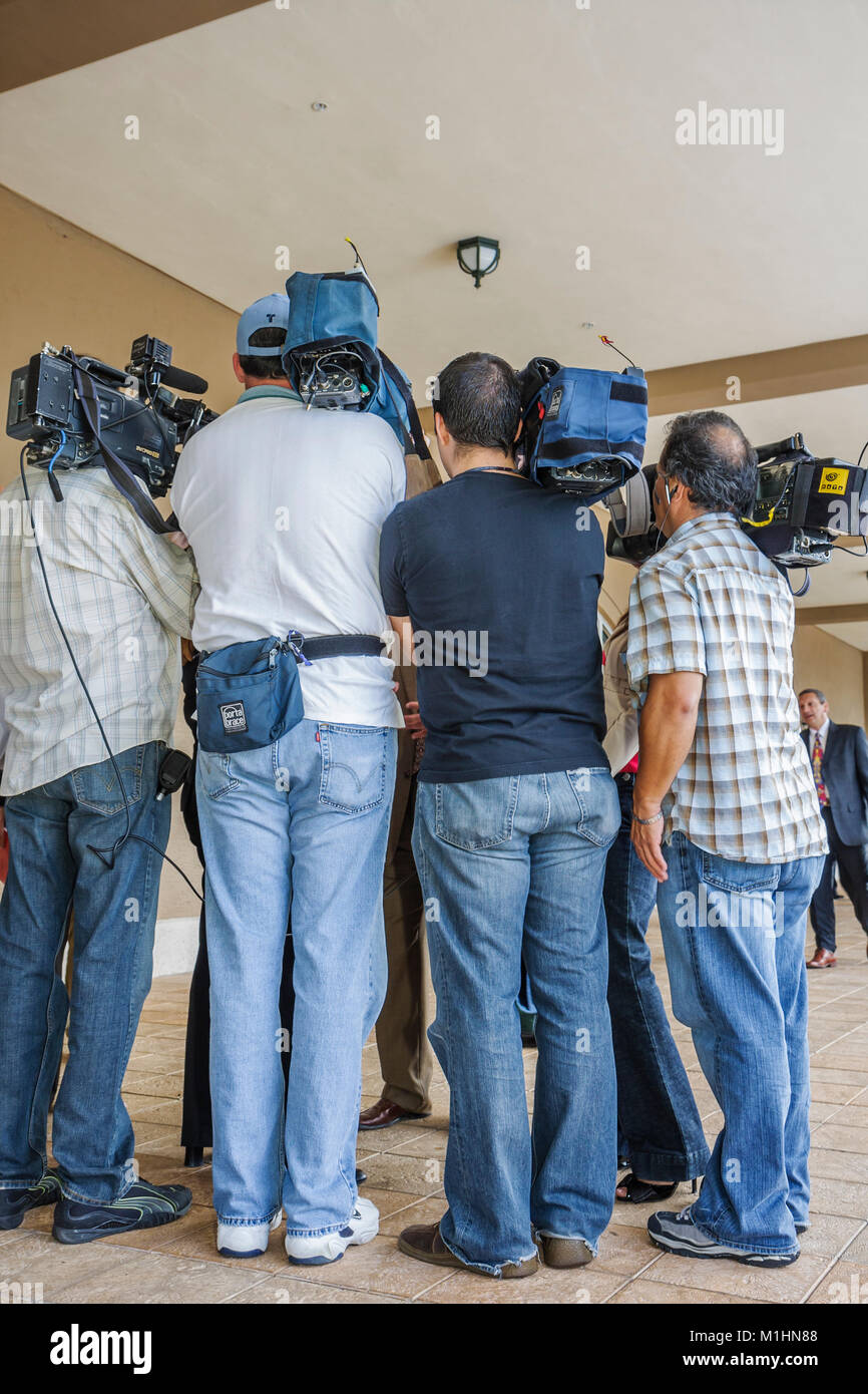 getting government contracts networking Mayor Manny Diaz media cameramen surround - Stock Image