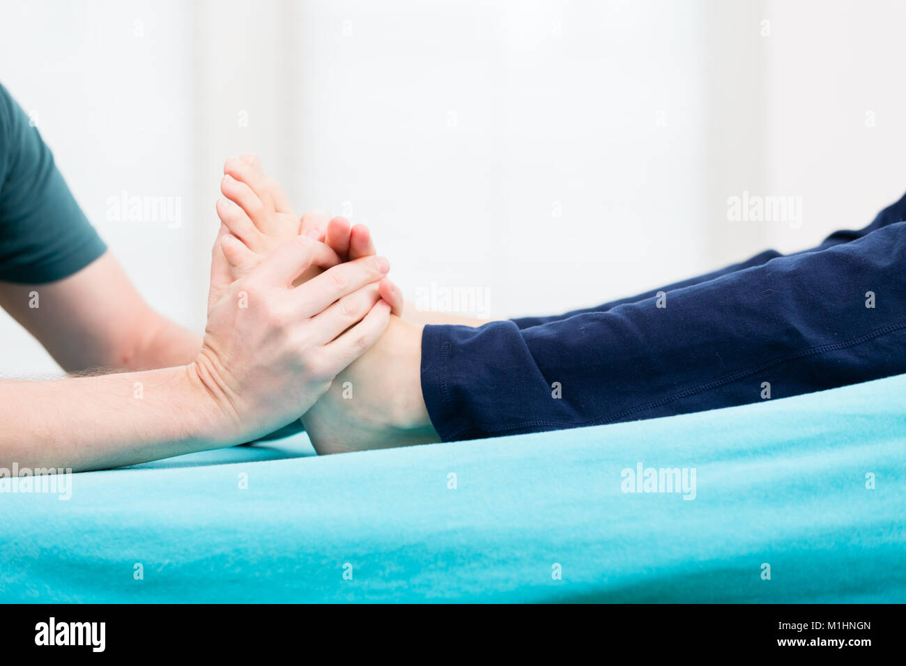 Patient having foot massage at physio - Stock Image