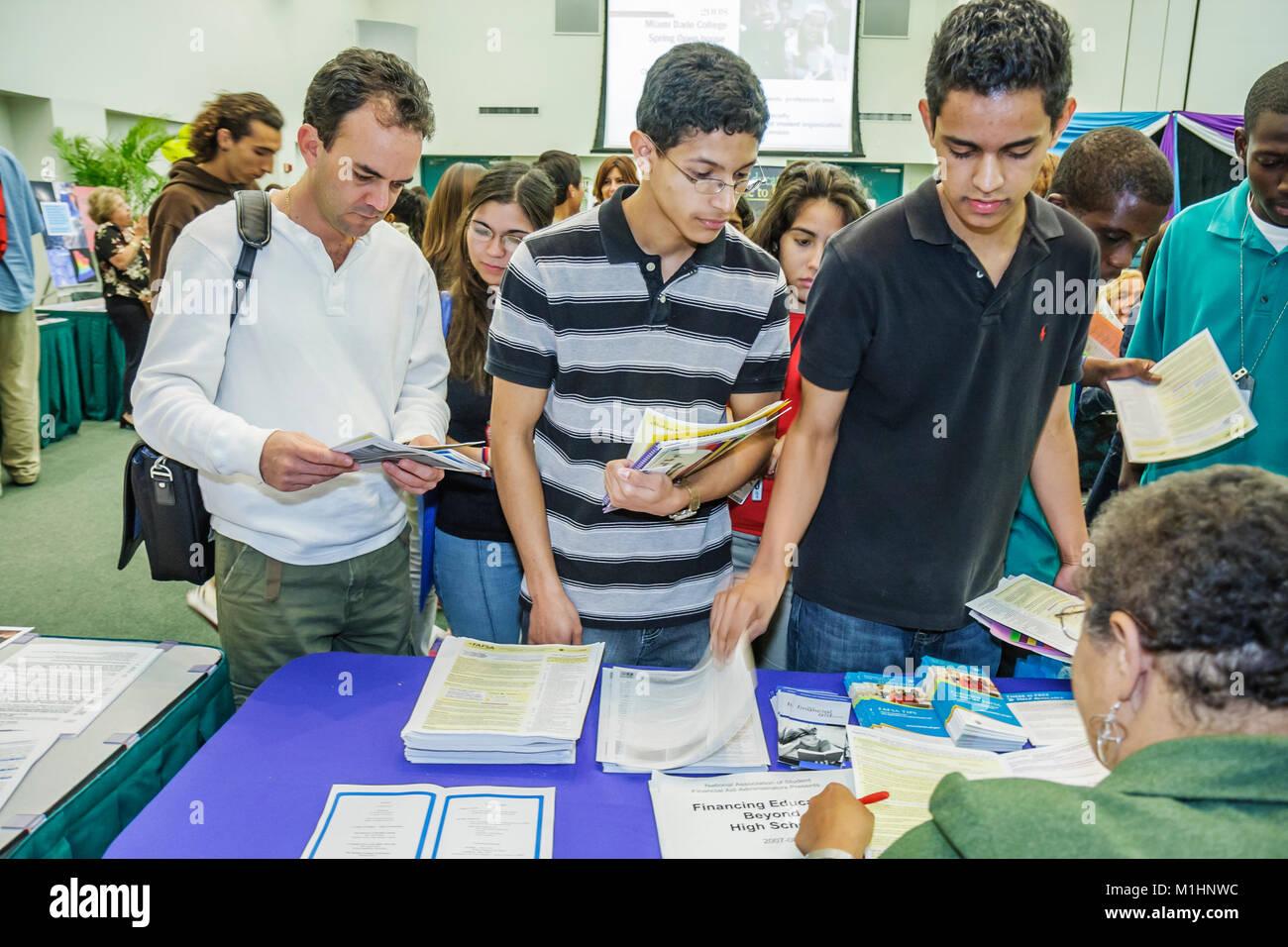 courses recruiter orientation counselor Hispanic teen boys man information - Stock Image