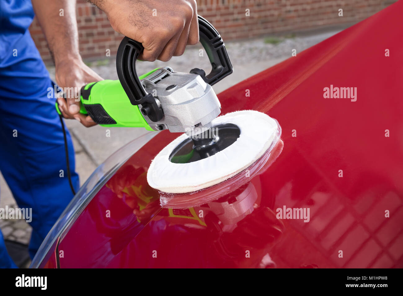 Close-up Of Person Hands Polishing Car With Orbital Polisher - Stock Image