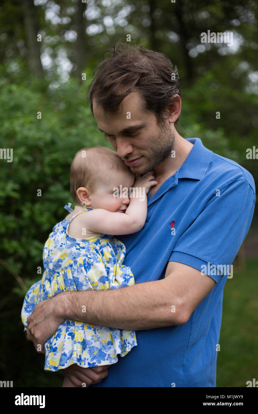 Man Holding Baby Outdoor - Stock Image
