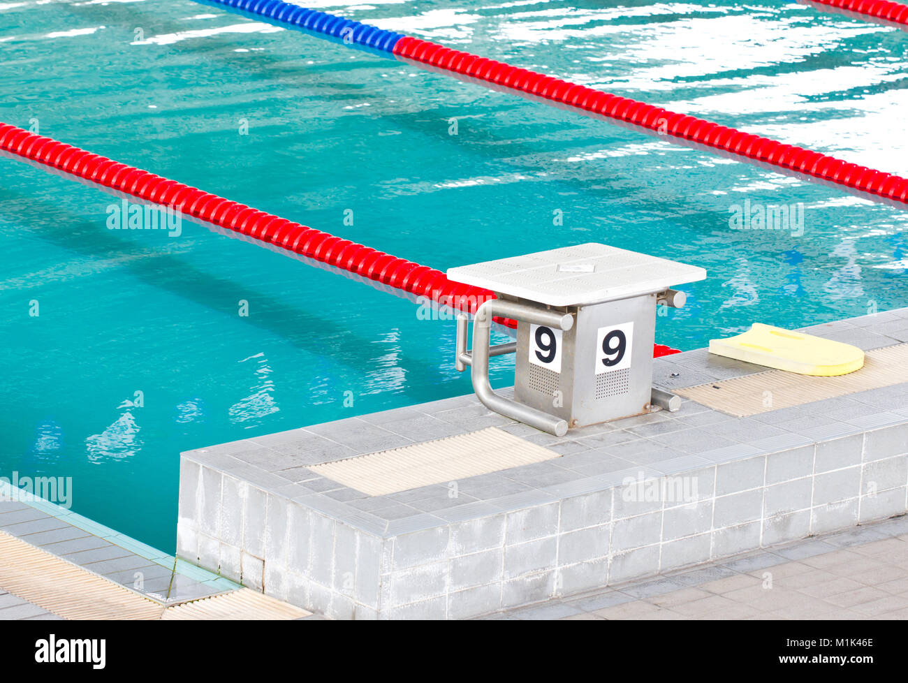 Empty swimming pool with starting block Stock Photo ...