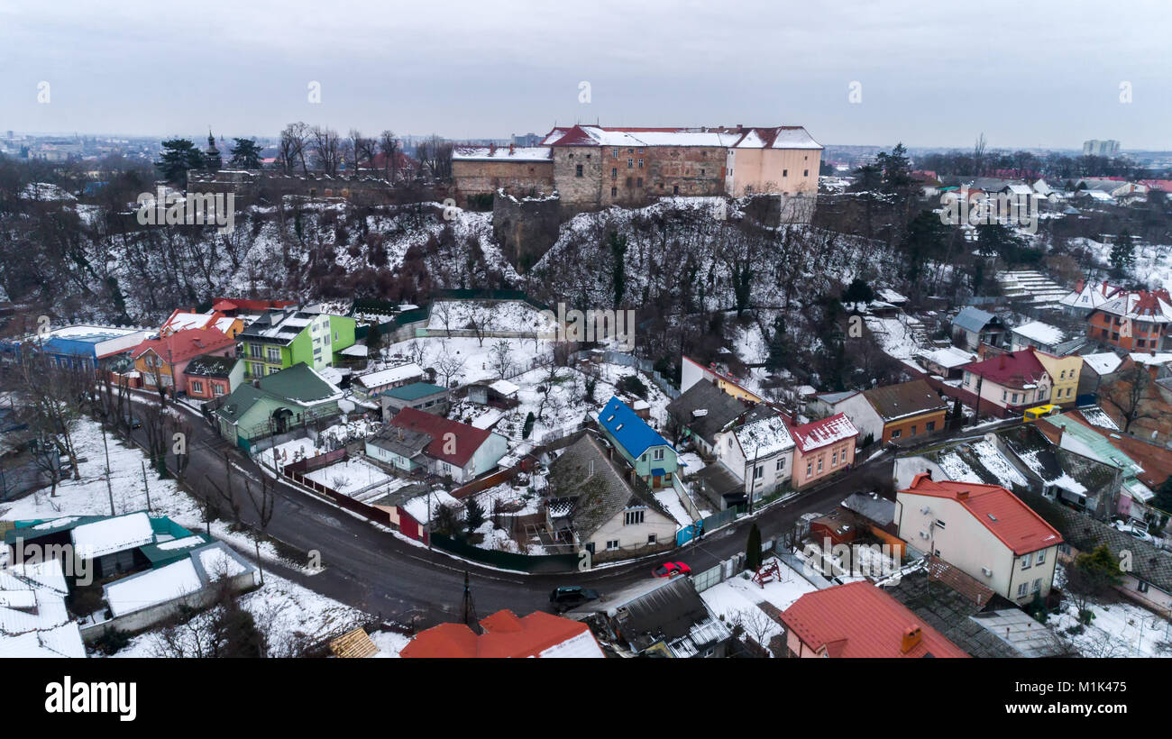 aerial beatiful grimly view on Uzhhorod Castle in winter. - Stock Image