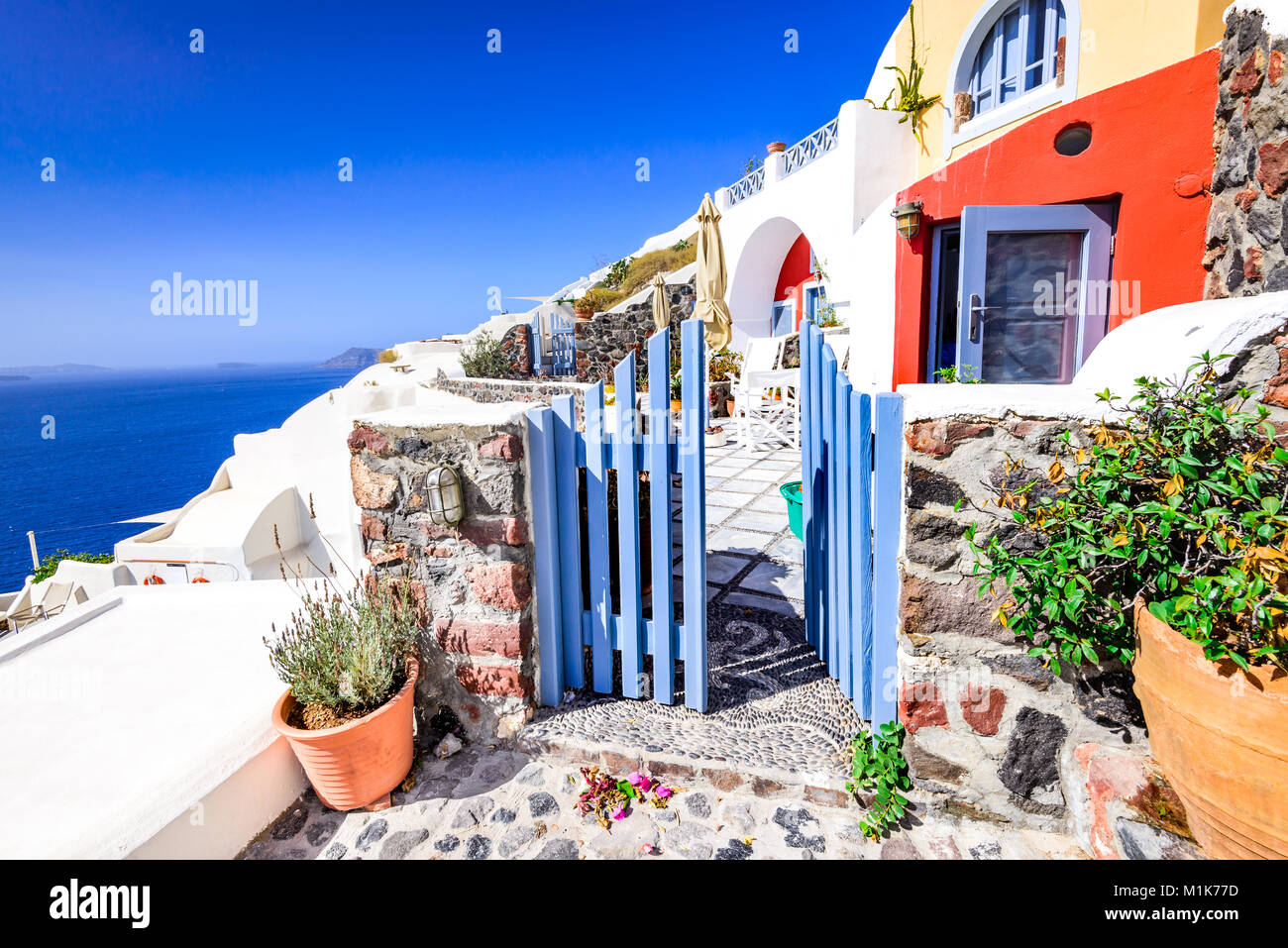 Oia, Santorini - Greece. Famous attraction of white village with cobbled streets and colored houses, Greek Cyclades - Stock Image