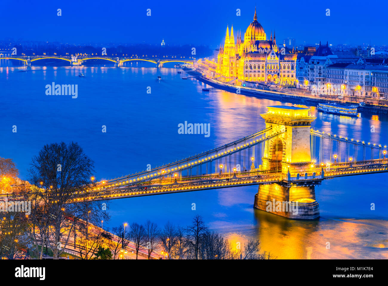 Budapest, Hungary. Szechenyi Chain Bridge and Hungarian Parliament Building over Danube River. - Stock Image