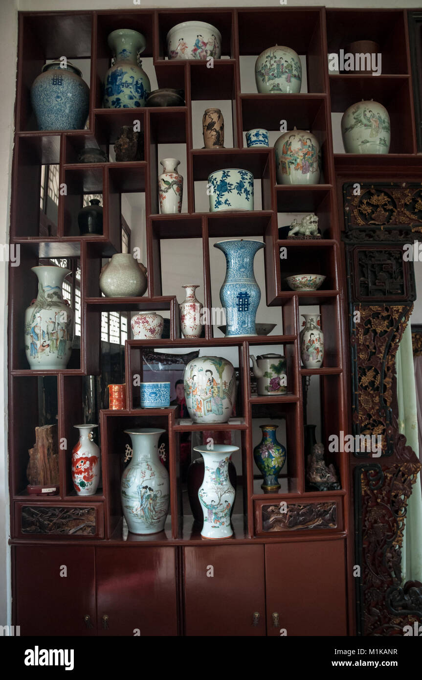 A Wooden Display Cabinet Displaying Part Of Wu Jianguou0027s Collection Of  Antique Chinese Vases. Located