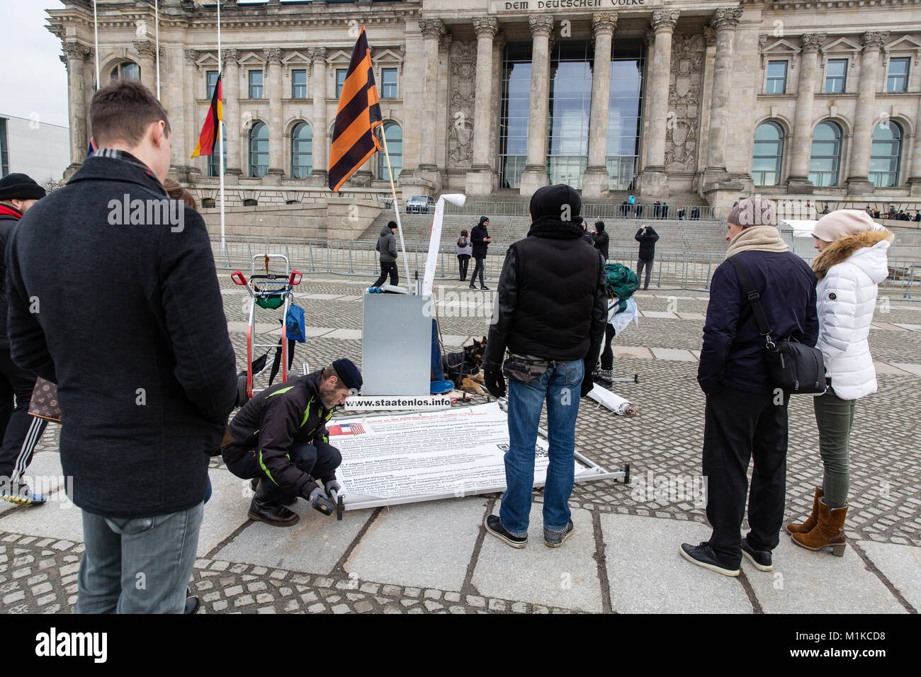 Activist in Berlin in front of the Reichstag Building setting up a picketing stand getting tourists attention. Stock Photo