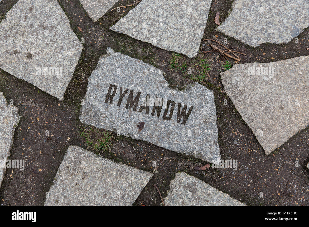 Rymanow - Names of death camps are engraved in stones at the Memorial to the Sinti and Roma Victims of National Stock Photo