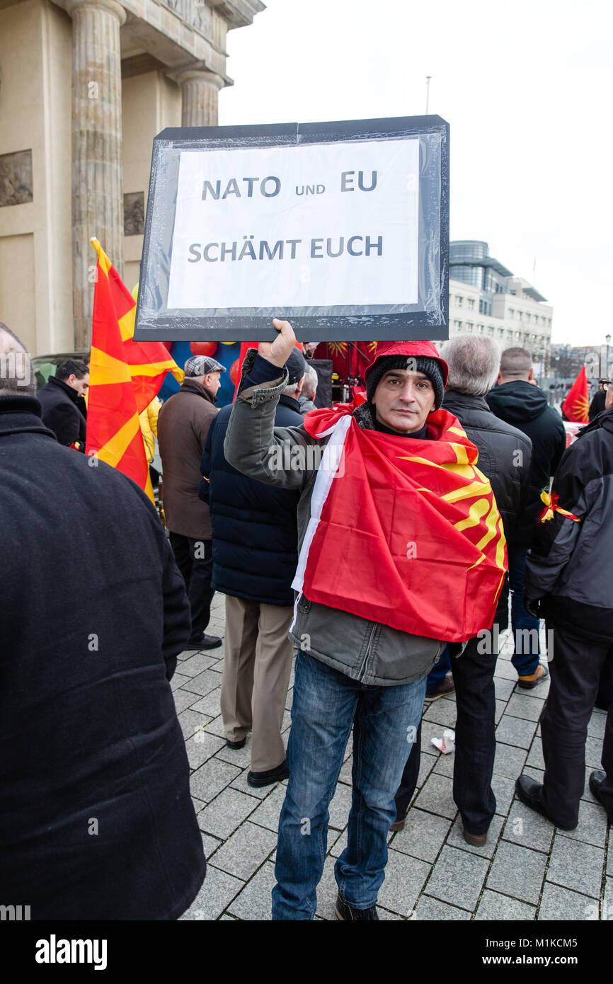 Macedonians living in Berlin staging a peaceful protest to demonstrate disapproval of Macedonian government policies - Stock Image