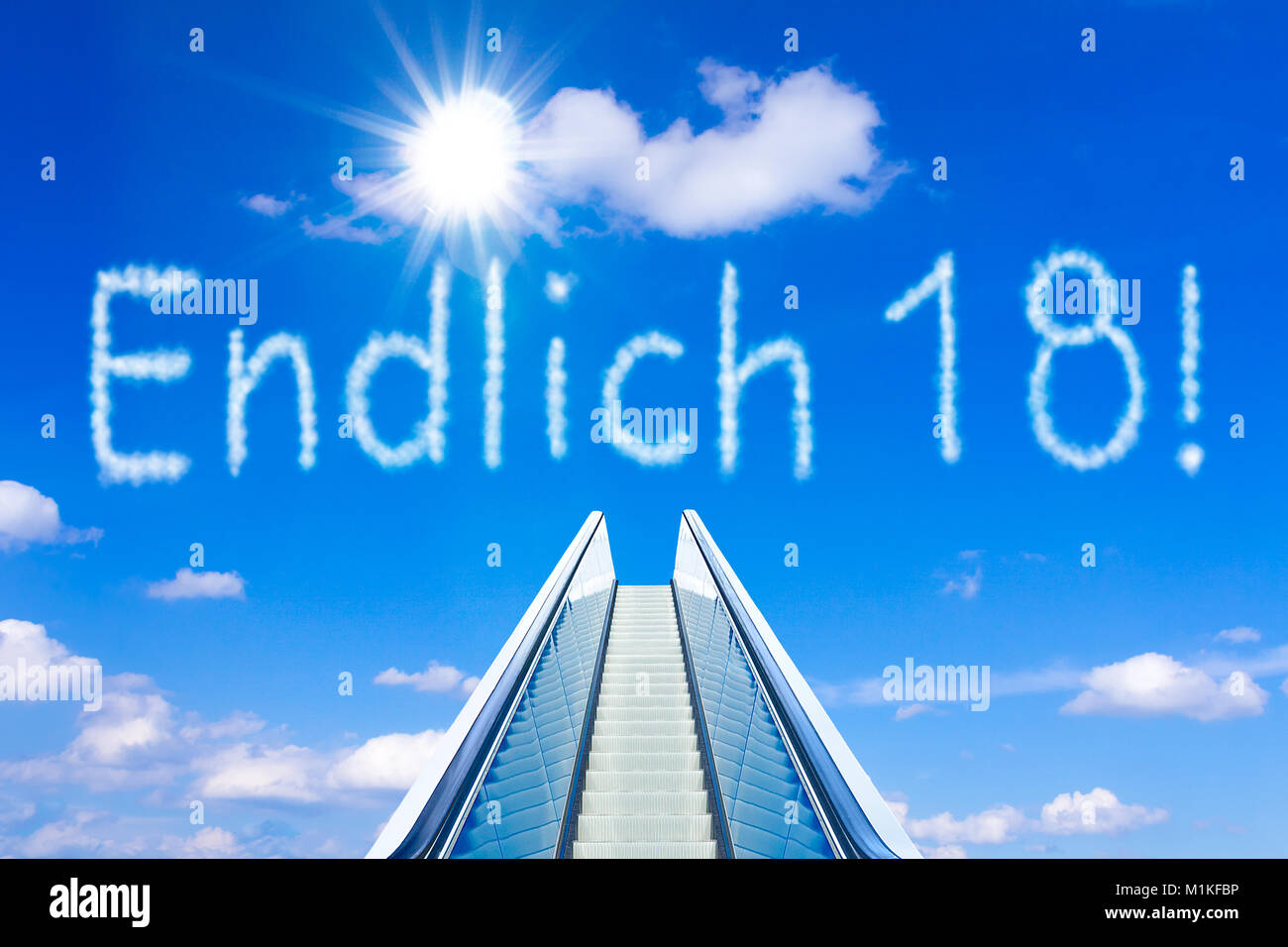 Escalator into a blue sky, concept of achievement, ENDLICH 18 german text, meaning FINALLY 18, adulthood and freedom Stock Photo