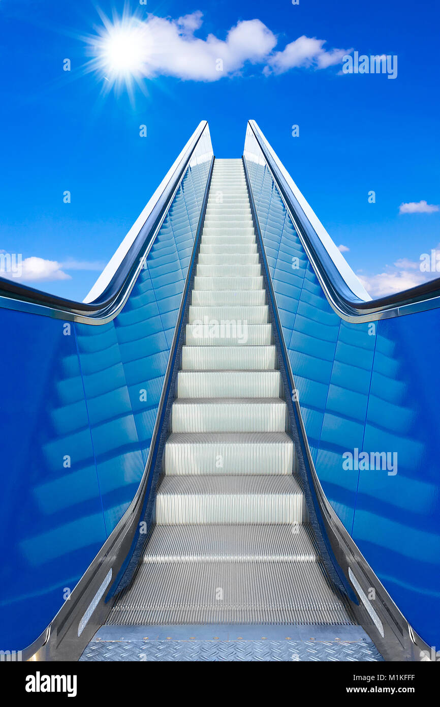escalator to the blue sky , concept of rising, way to success or heaven, prospect of a bright future Stock Photo