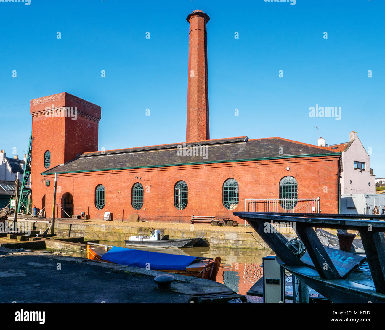 The Victorian pump room building at Underfall Yard boatyard on the floating harbour in Bristol UK which powered - Stock Image