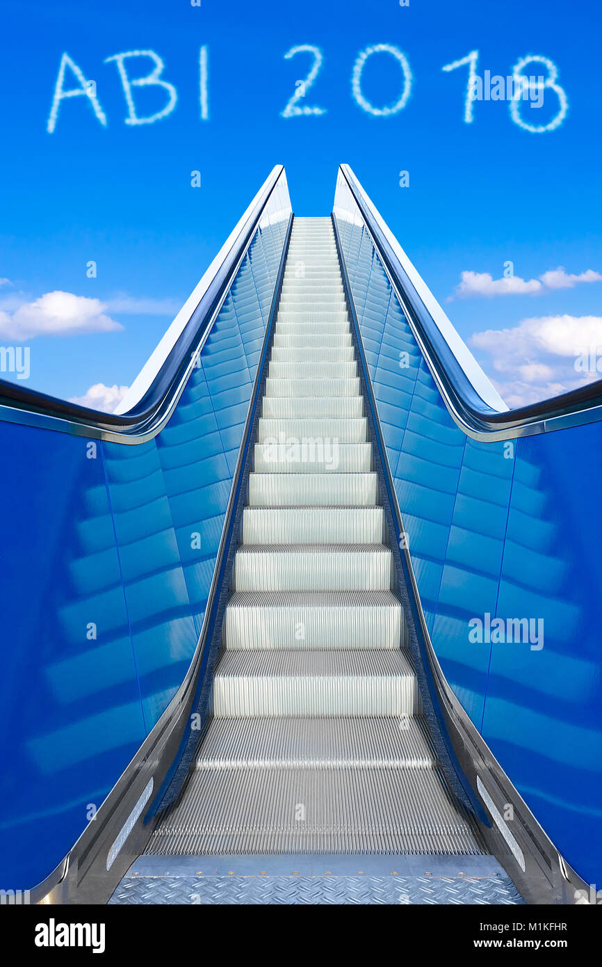 Escalator into a blue sky, concept of achievement, ABI 2018 german text, Abitur meaning high school graduation or Stock Photo