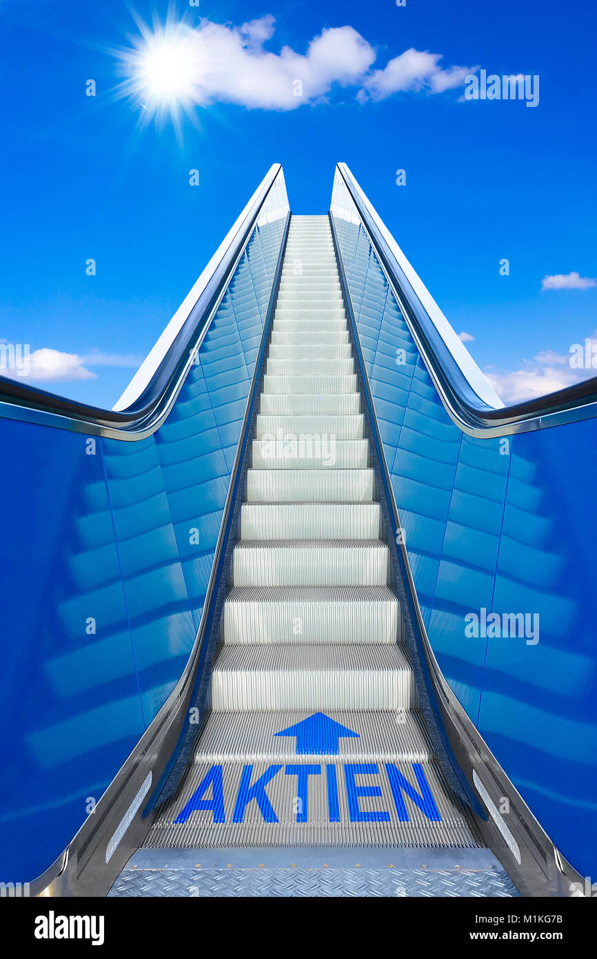 Escalator into a blue sky with german text AKTIEN meaning shares, concept of achievement, making big profits at Stock Photo
