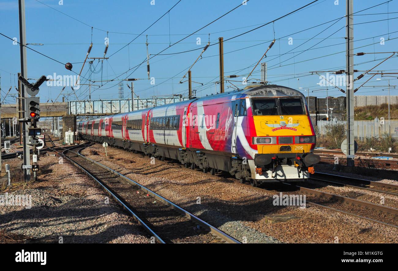 Virgin East Coast Express heads away north from Peterborough, Cambridgeshire, England, UK - Stock Image