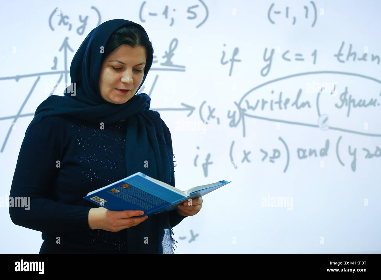 MAKHACHKALA, RUSSIA - JANUARY 30, 2018: A teacher in a headscarf during a maths lesson at the Centre for Gifted - Stock Image