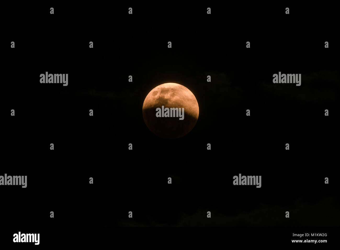 Singapore, Singapore - Jan 31, 2018: A rare view of the special `super blue blood moon` during a total lunar eclipse - Stock Image