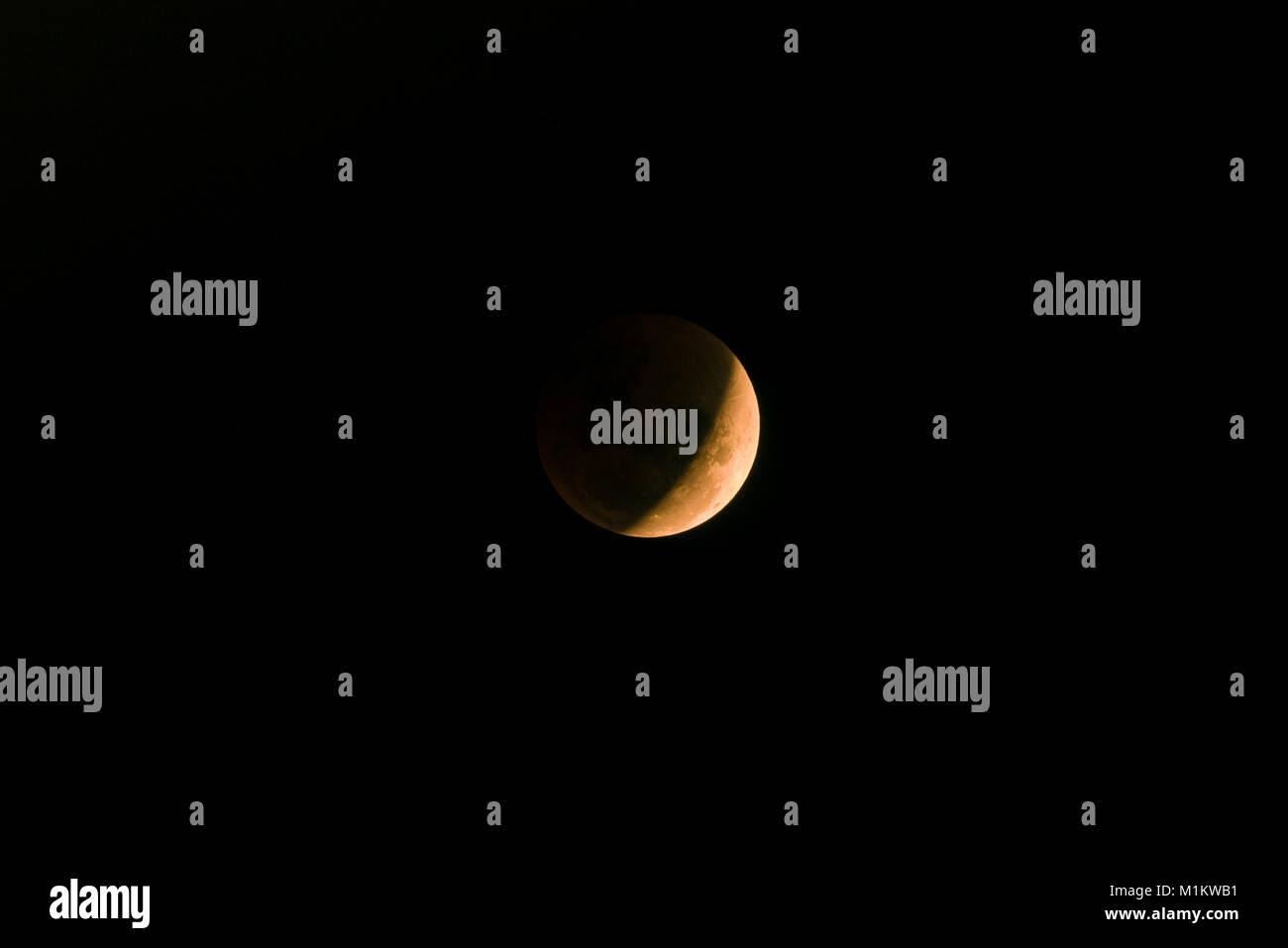 Singapore, Singapore, Jan 31, 2018: The rare `super blue blood moon` near a total lunar eclipse viewed in Singapore - Stock Image