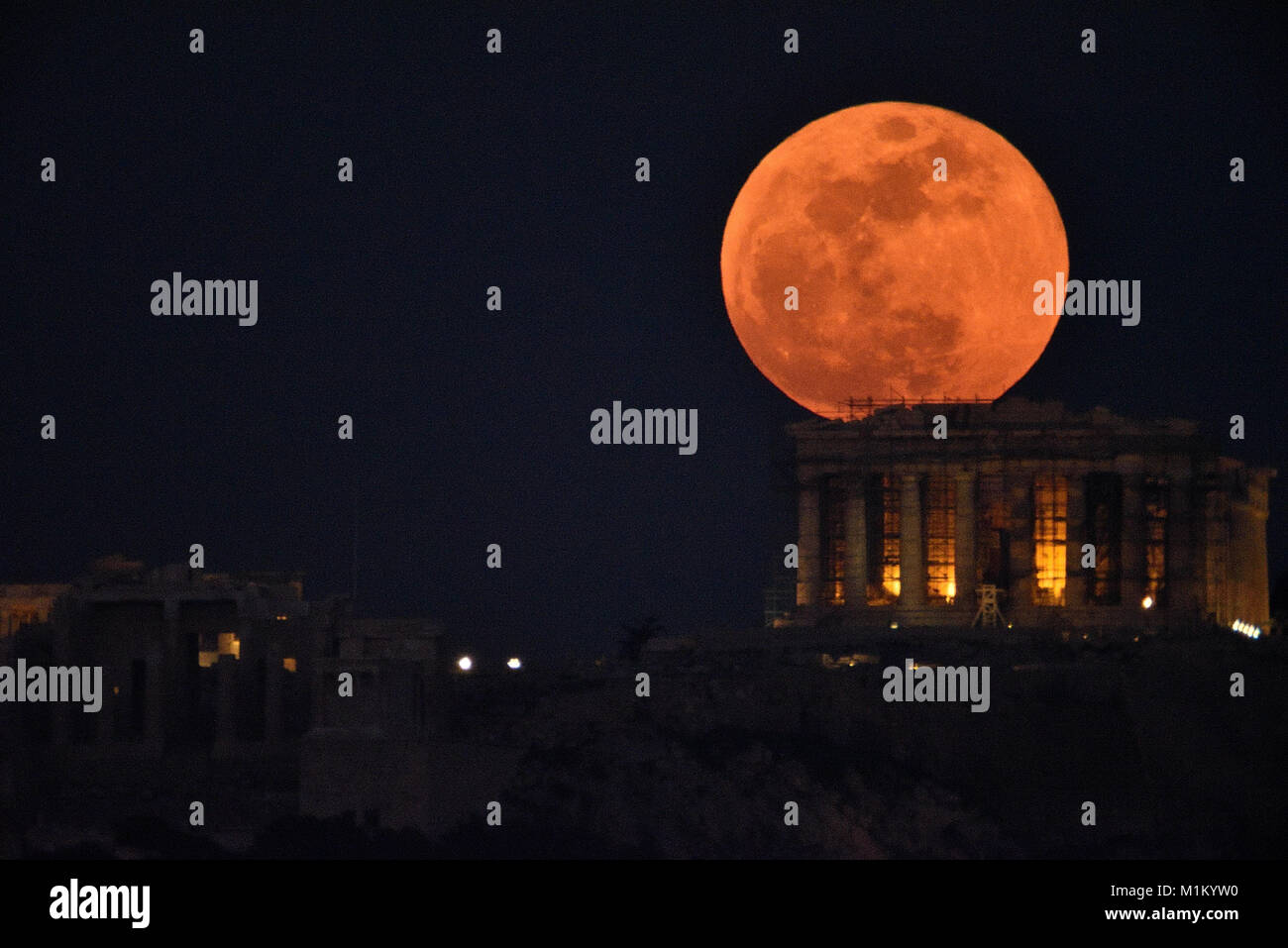 Athens, Greece, 31st January, 2018. Super blue blood moon rises over the Acropolis of Athens in Athens, Greece. - Stock Image