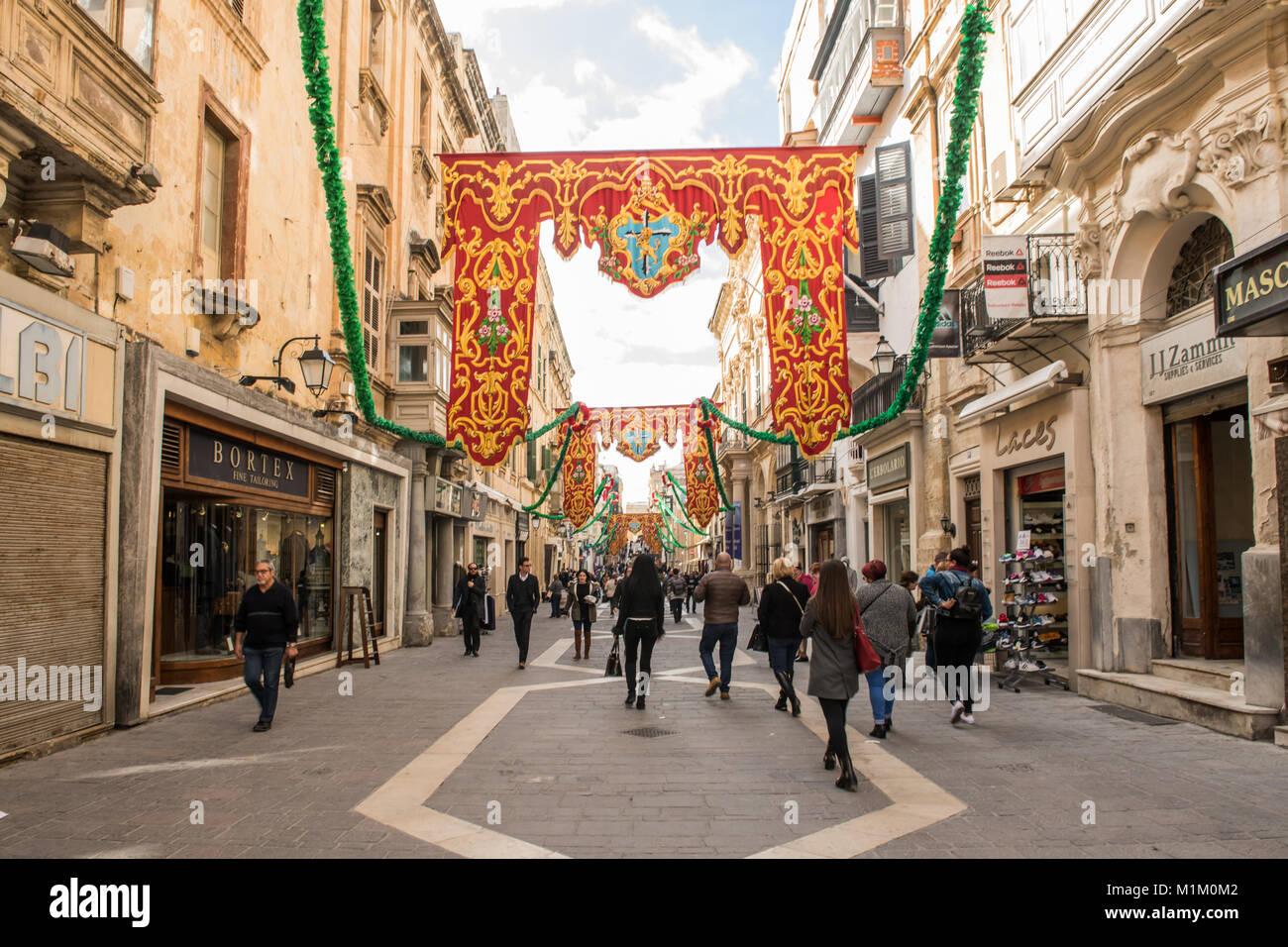 Valletta, Malta. 19th Jan, 2018. Pedestrians walk along the a street in the city centre of Valletta, Malta, 19 January - Stock Image