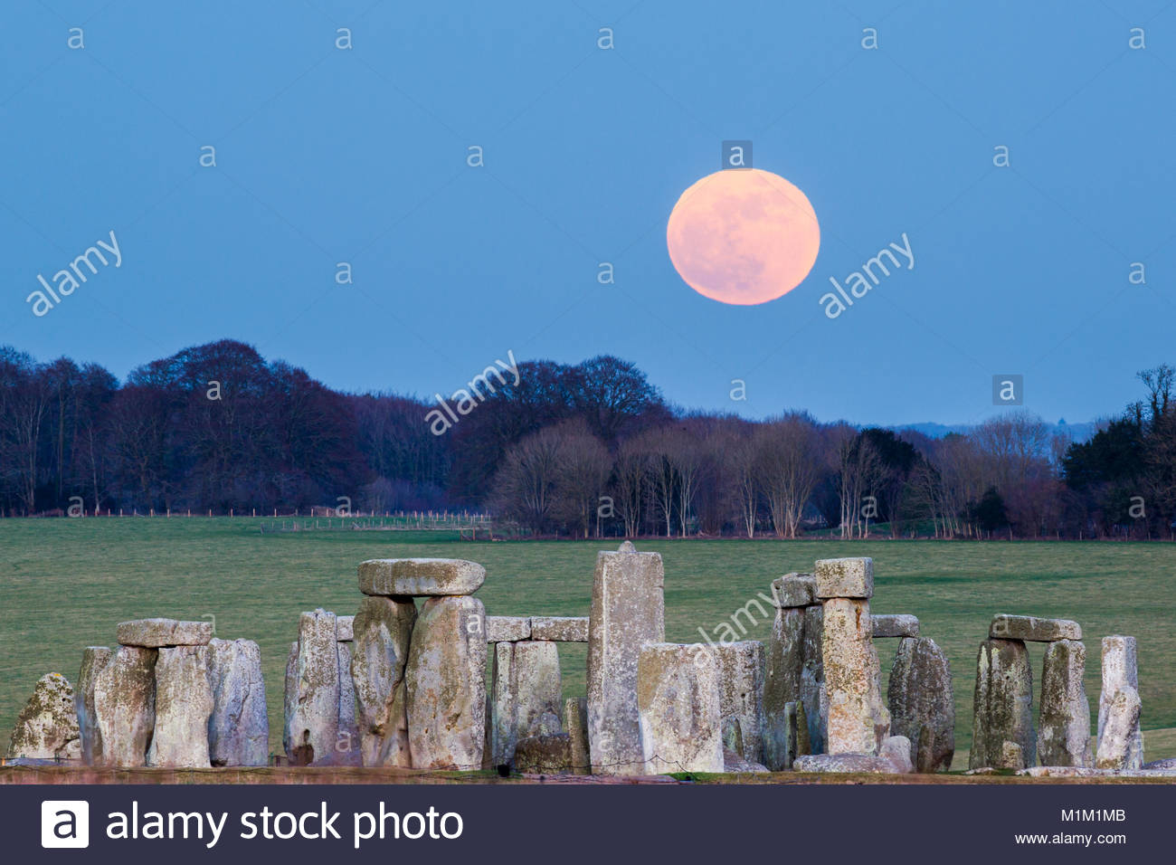 Stonehenge, UK. 31st Jan, 2018. Super Blue Blood Moon is seen rising over Stonehenge stone circle on Wednesday, - Stock Image