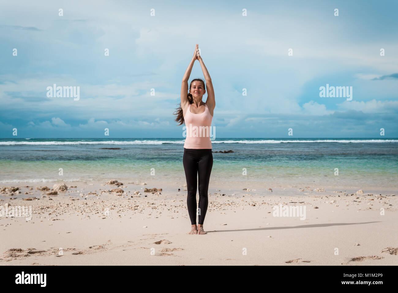 Woman Standing A Namaste Yoga Pose On The Beach Sun Greeting