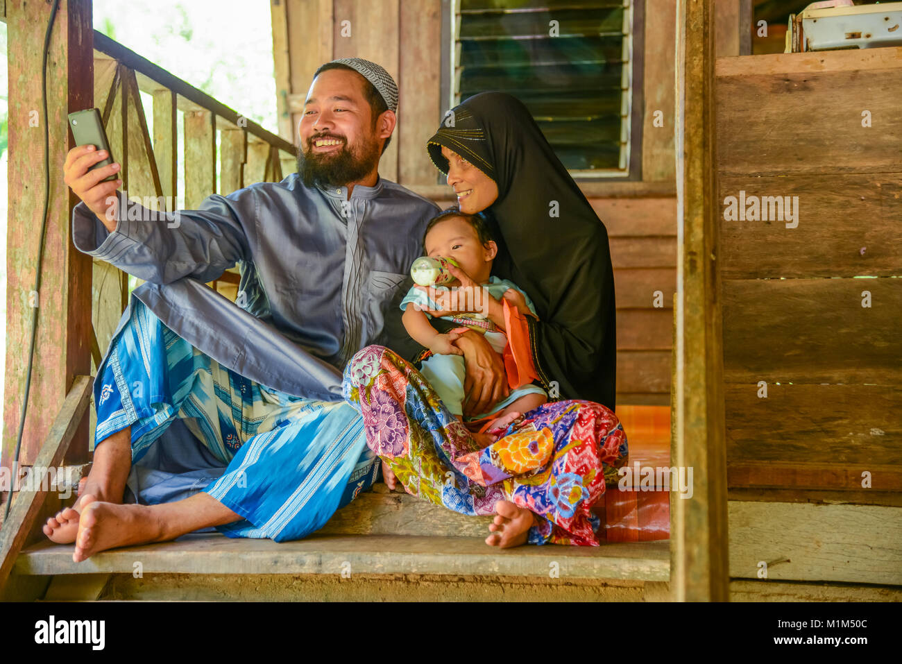 KRABI, THAILAND - MAY 2, 2015: Lovely Muslim family selfie themselves. in home in Lanta island of Krabi, Thailand - Stock Image