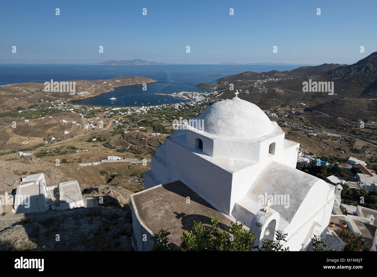 View over Livadi Bay and white Greek Orthodox church from top of Pano Chora, Serifos, Cyclades, Aegean Sea, Greek - Stock Image
