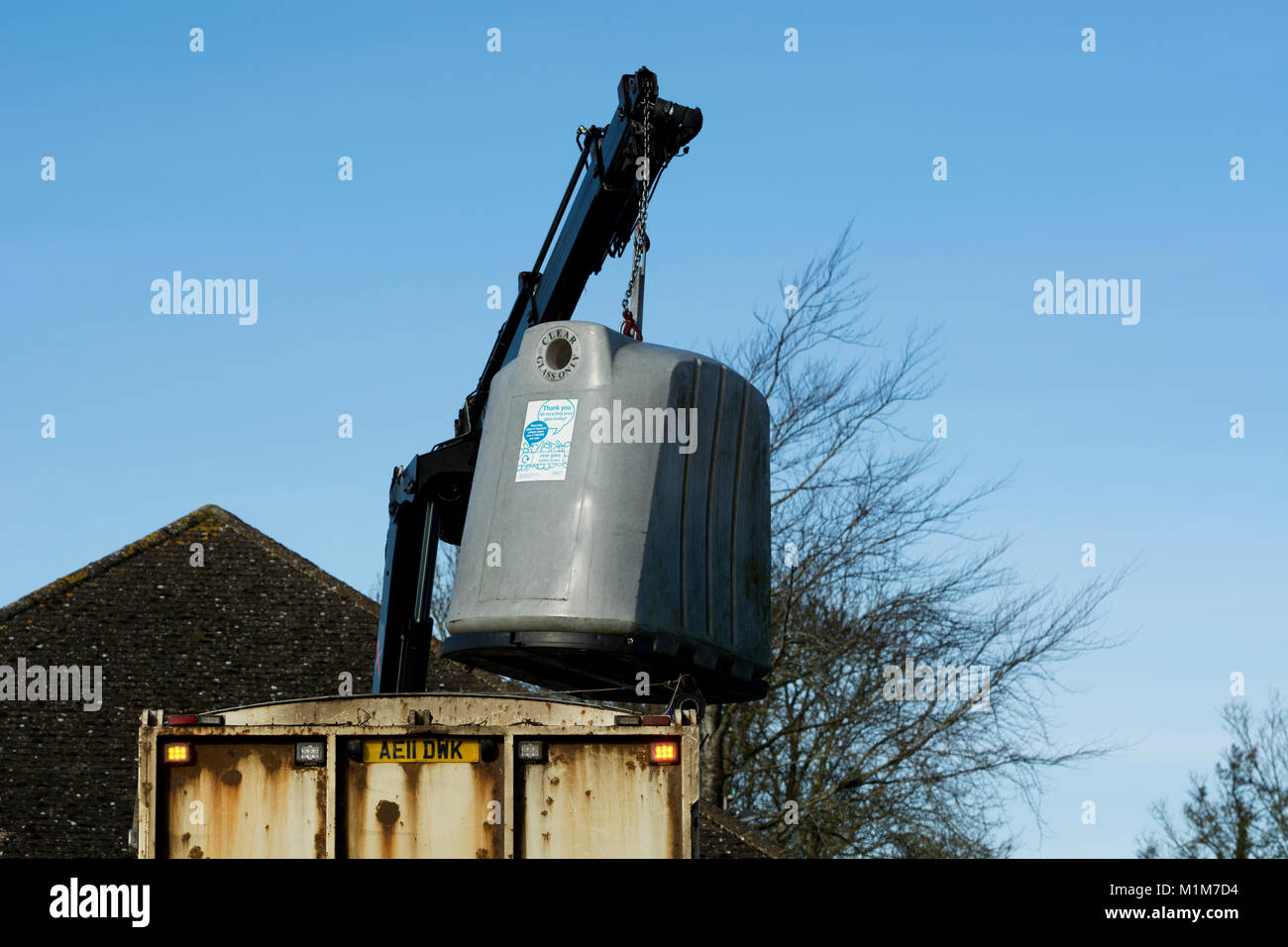 Glass recycling bin being emptied, Oxfordshire, UK - Stock Image