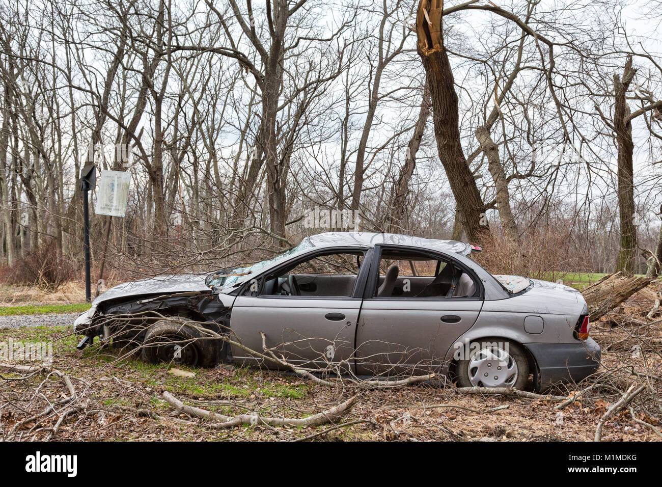 An abandoned car that was wrecked in an accident - Stock Image