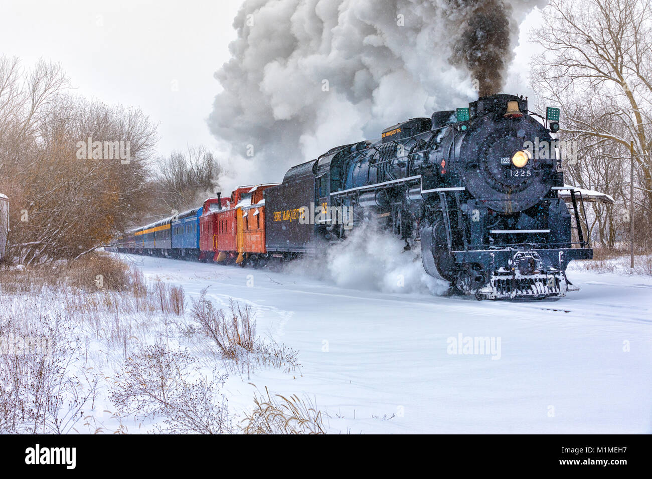 """The Pere Marquette 1225 """"North Pole Express"""" steams along snowy track on a winter day. Stock Photo"""