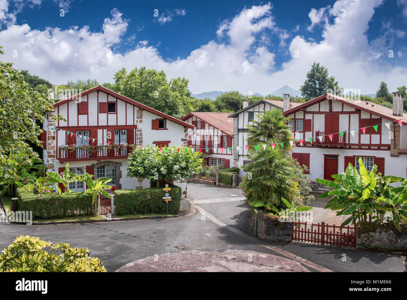 Traditional Labourdine houses in the village of Ainhoa, Basque country, France - Stock Image