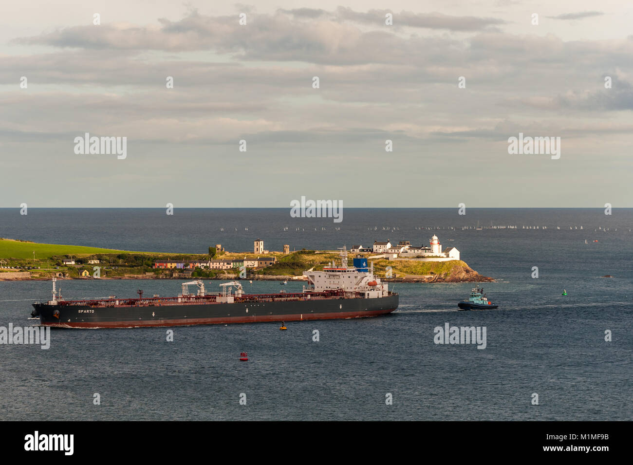 Crude Oil Tanker 'Sparto' passes Roches Point lighthouse, County Cork, Ireland on her way to Whitegate Oil - Stock Image