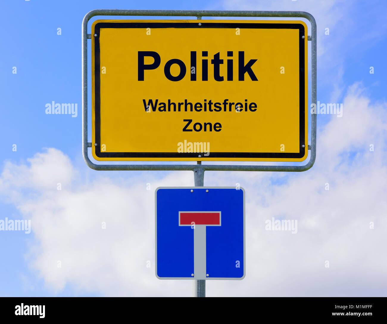 Politik in der wahrheitsfreien Zone auf Ortsschild - Stock Image