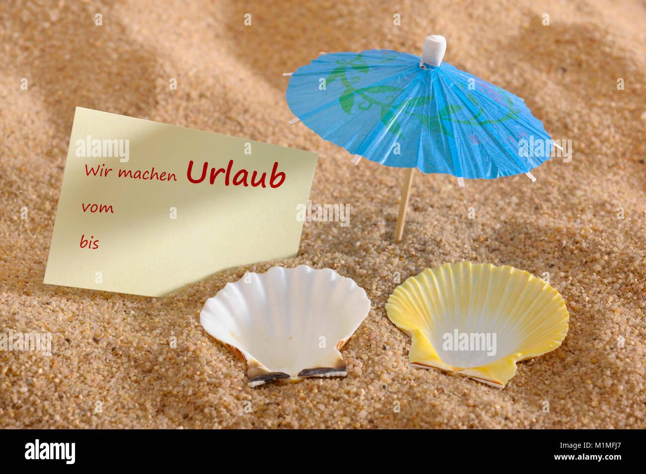 Urlaub und Ferien am Sandstrand mit Abwesenheitsnotiz - Stock Image
