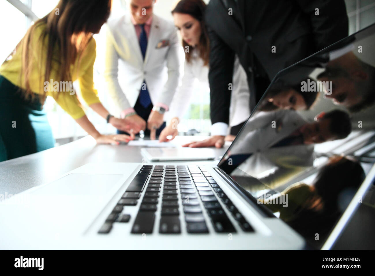 Business team discussing together business plans - Stock Image