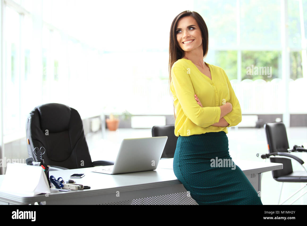 Modern business woman in the office with copy space. - Stock Image