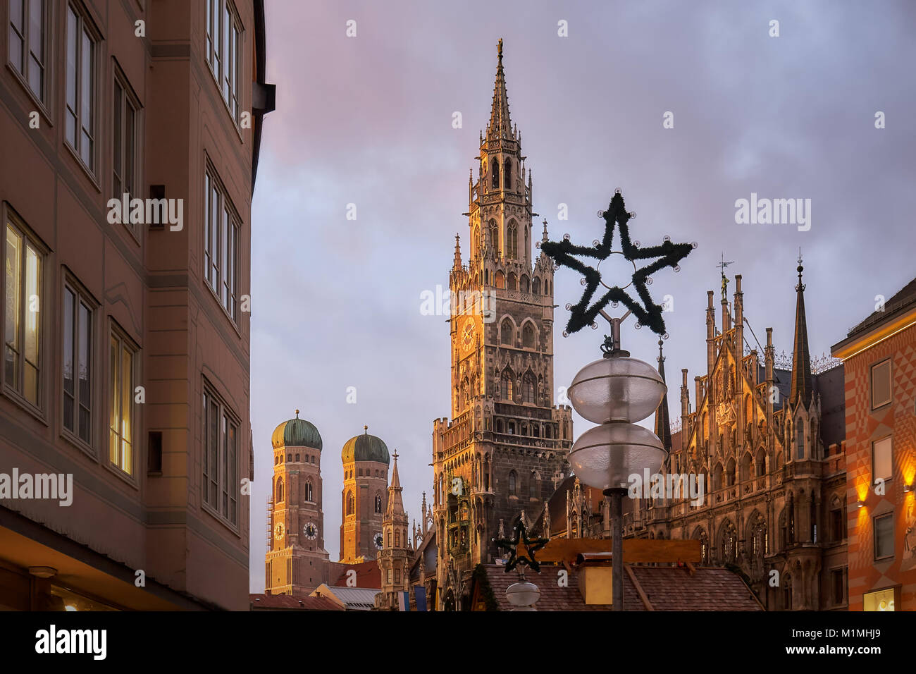 Marienplatz square in Munich with New Town Hall (Rathaus) and The Frauenkirche church in frame - Stock Image