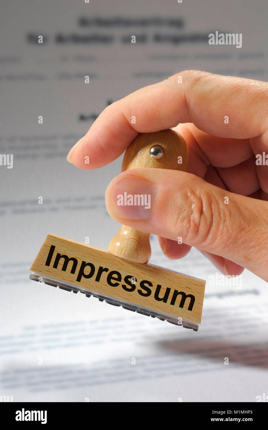 Impressum marked on rubber stamp - Stock Image