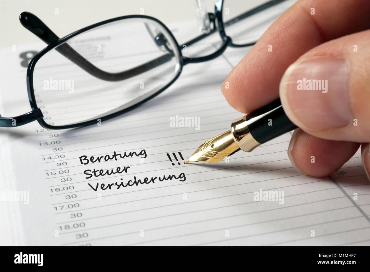 Terminplaner mit Eintrag Beratung - Stock Image