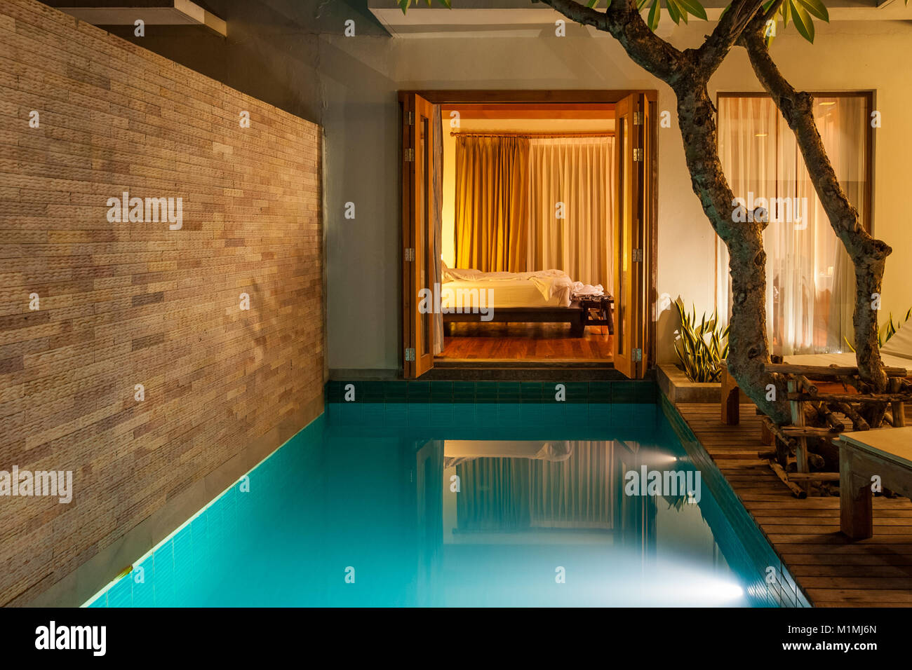 A Night Shot Of A Pool Villa Which Has A Garden With A Swimming Pool Stock Photo Alamy