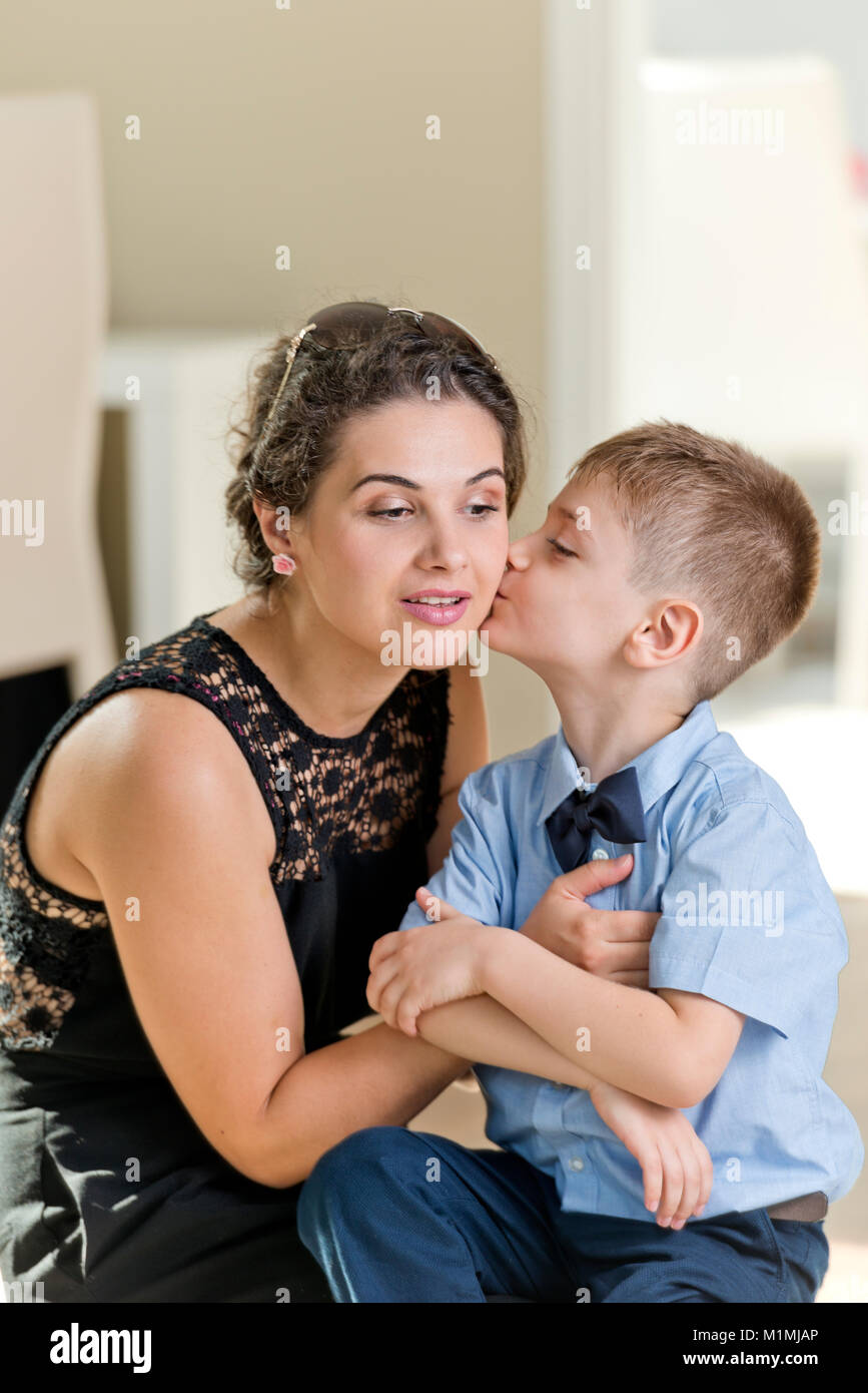 Six years old boy preparing for his first day of school, in blue shirt, at home. Stock Photo