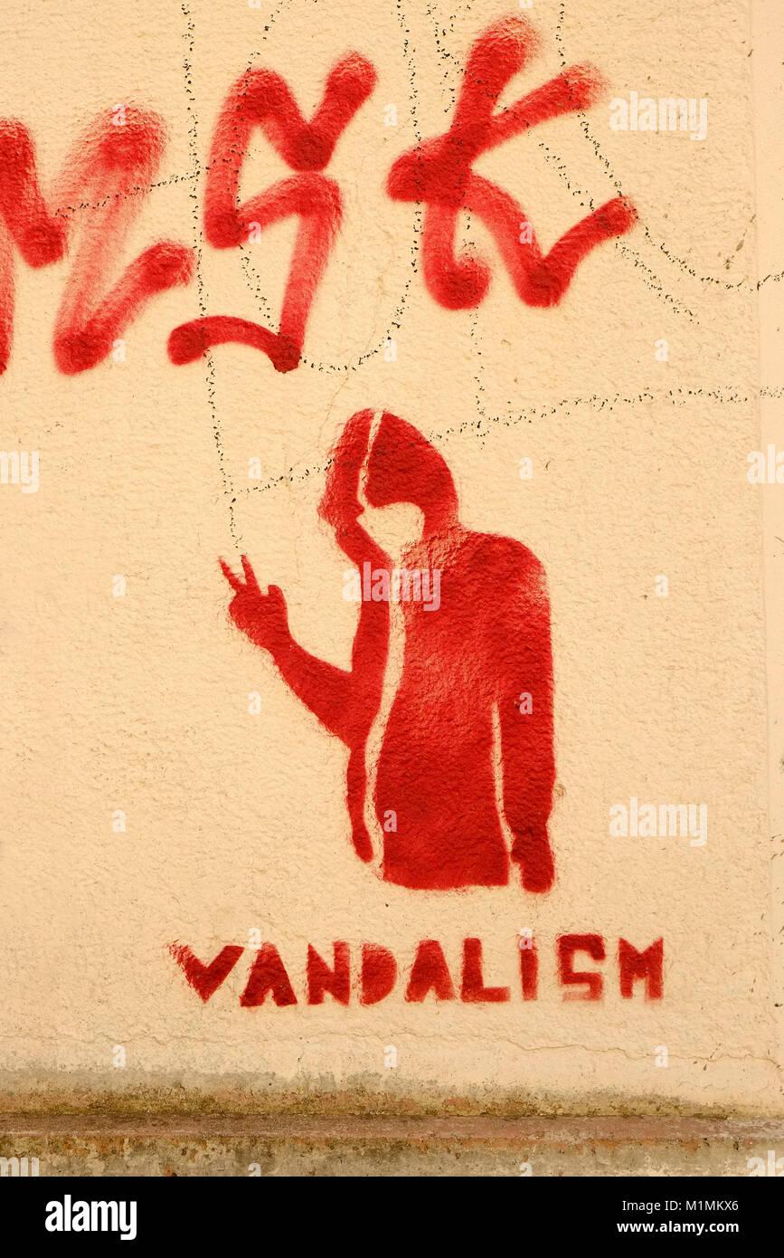 vandalism graffiti painted on building wall, sardinia, italy - Stock Image
