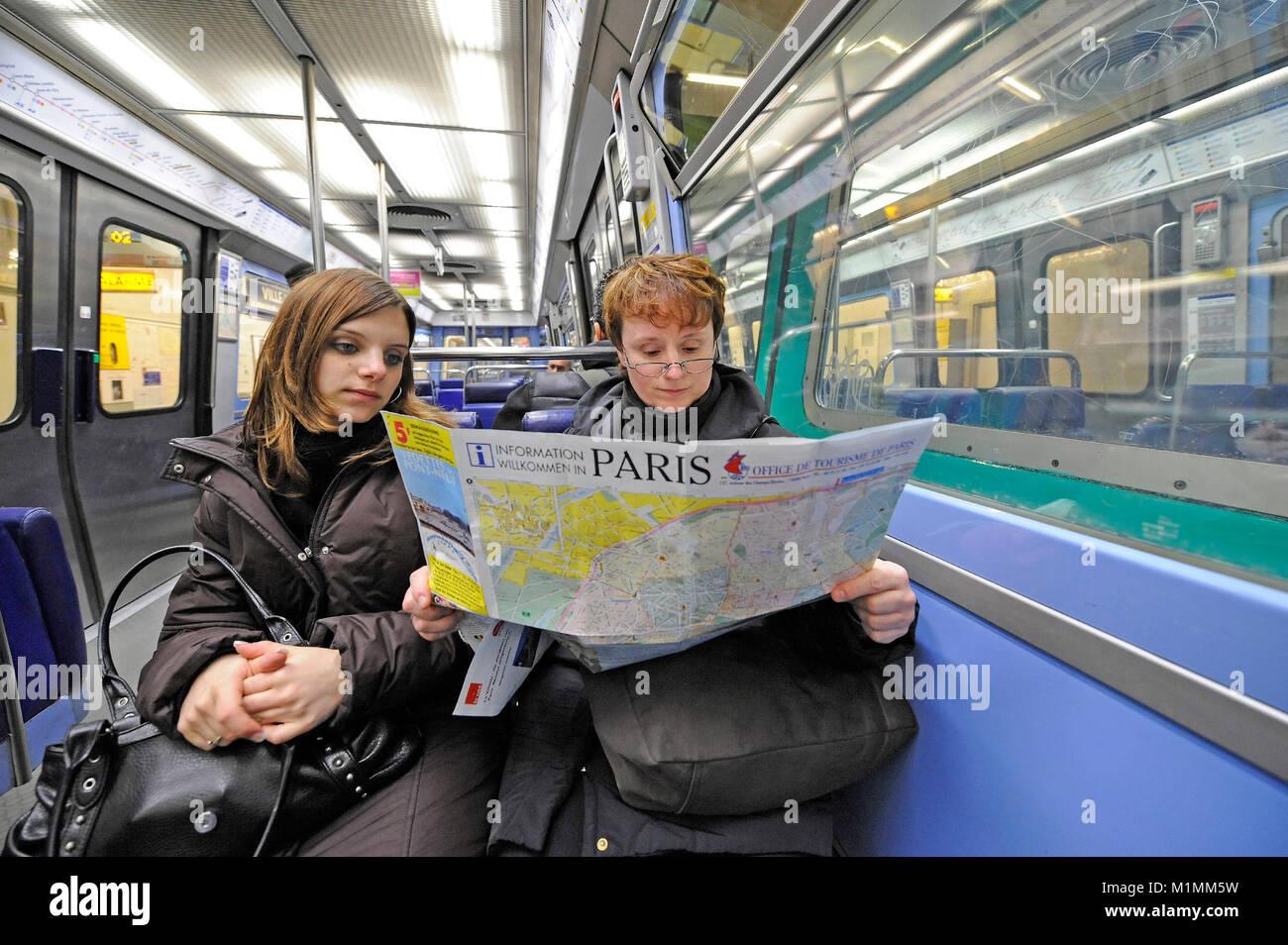 Tourists in Metro Paris, France, Touristen in Metro Paris, Frankreich - Stock Image