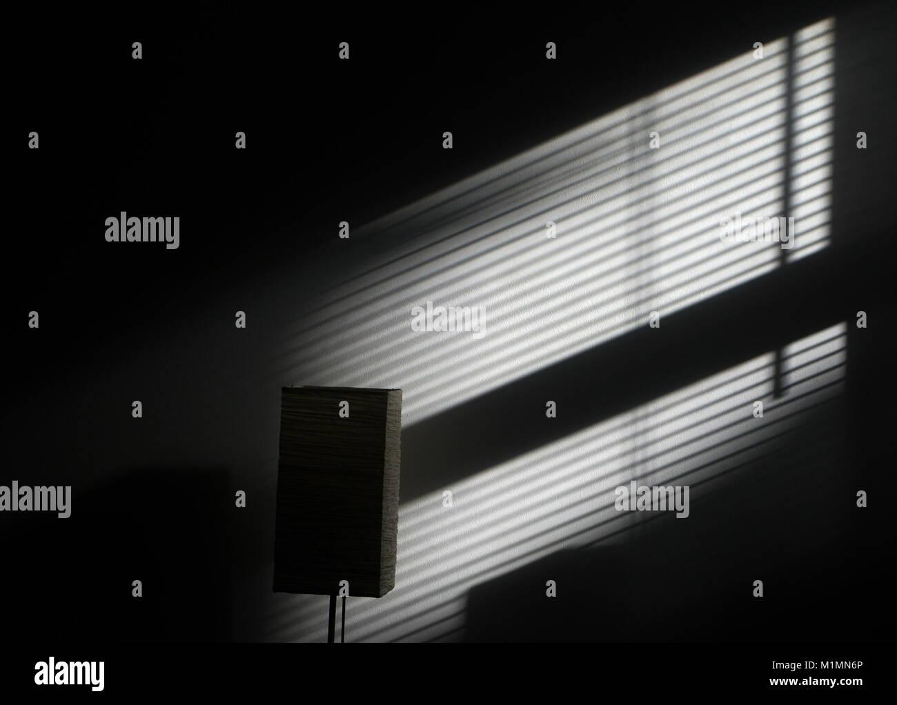 Light and shadow on wall - Stock Image